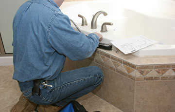 Denver plumber installs brushed alluminum fixtures
